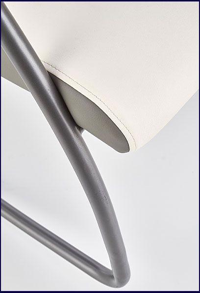 Biały fotel na biegunach do salonu Dixon